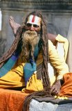 They are known, variously, as sadhus (saints, or 'good ones'), yogis (ascetic practitioners), fakirs (ascetic seeker after the Truth) and sannyasins (wandering mendicants and ascetics). They are the ascetic – and often eccentric – practitioners of an austere form of Hinduism. Sworn to cast off earthly desires, some choose to live as anchorites in the wilderness. Others are of a less retiring disposition, especially in the towns and temples of Nepal's Kathmandu Valley.<br/><br/>If the Vale of Kathmandu seems to boast more than its share of sadhus and yogis, this is because of the number and importance of Hindu temples in the region. The most important temple of Vishnu in the valley is Changunarayan, and here the visitor will find many Vaishnavite ascetics. Likewise, the most important temple for followers of Shiva is the temple at Pashupatinath.<br/><br/>Vishnu, also known as Narayan, can be identified by his four arms holding a sanka (sea shell), a chakra (round weapon), a gada (stick-like weapon) and a padma (lotus flower). The best-known incarnation of Vishnu is Krishna, and his animal is the mythical Garuda.<br/><br/>Shiva is often represented by the lingam, or phallus, as a symbol of his creative side. His animal is the bull, Nandi, and his weapon is the trisul, or trident. According to Hindu mythology Shiva is supposed to live in the Himalayas and wears a garland of snakes. He is also said to smoke a lot of bhang, or hashish.